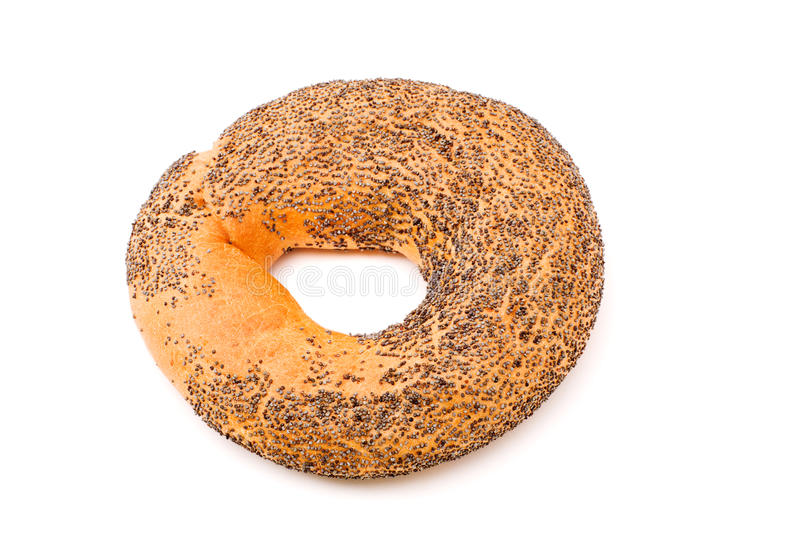 One bagel. With poppy seeds isolated on white royalty free stock photo