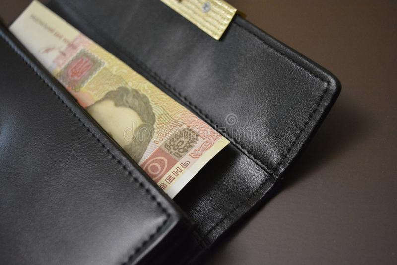 Twenty dollars is on a black wallet made from genuine cowhide leather. One banknote, US currency and dream. Payment for services,. One banknote, US currency and royalty free stock images