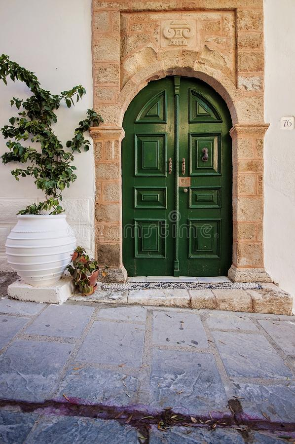 One beautiful entrance door, green painted wooden outdoor in Greece, Rhodes. One beautiful entrance door, green painted wooden outdoor in Greece Rhodes royalty free stock images