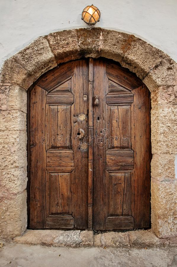 One beautiful entrance door or wooden outdoor in Greece, Rhodes. One beautiful entrance door or wooden outdoor in Greece Rhodes royalty free stock photography