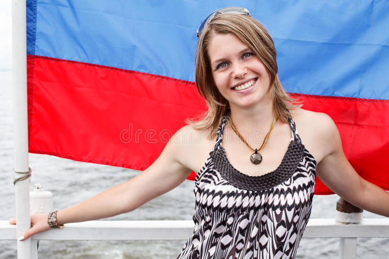 One beautiful woman unde Rusian flag royalty free stock photography