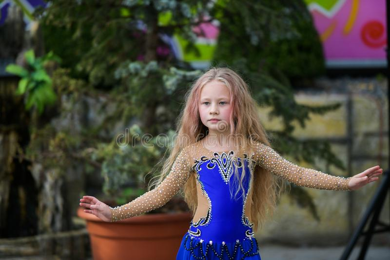 One beautiful young girl fits a modern dancer in a blue suit, a young dancer, dancing and jumping, Dance with a scarf royalty free stock photography