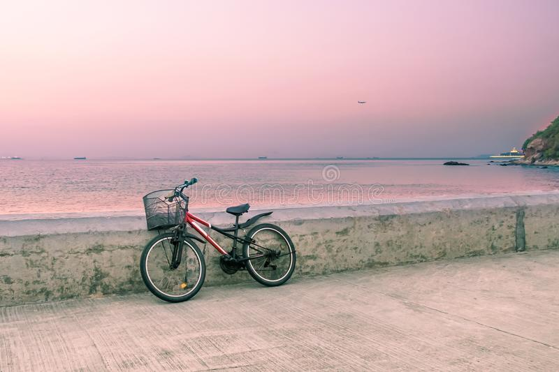 Lonely bicycle standing on concrete pier. royalty free stock images