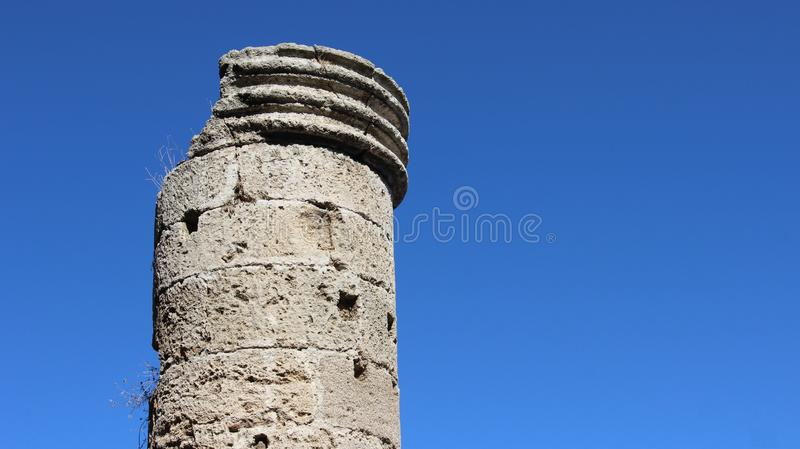 One Big Old Stone Pillar In Historic Old Town. Historic old town of medieval town and big old pole with clear blue sky in Rhodes Greece royalty free stock photos