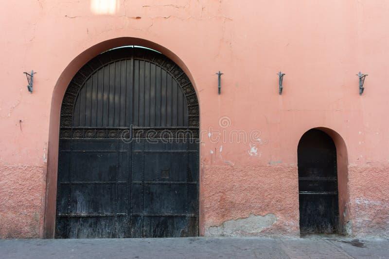 One Big and One Small Door in Marrakesh Morocco. One big door next to a small door on the outside of a building in Marrakesh Morocco stock image