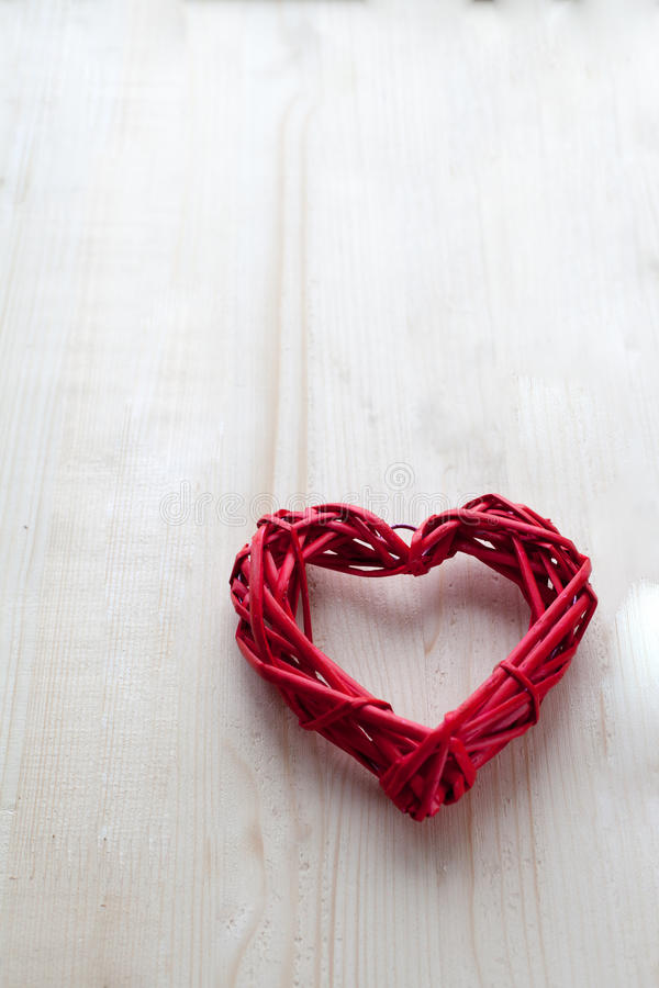 One big red heart on the background of wooden boards, Valentine`s day, the holiday of love. One big red heart on the background of wooden boards, Valentine`s day stock image