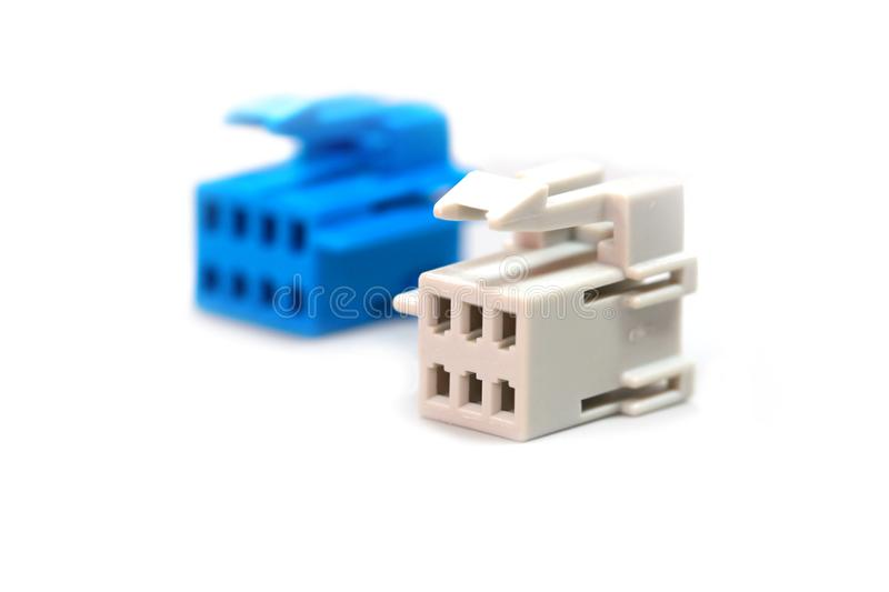 One blue and one white connector stock image