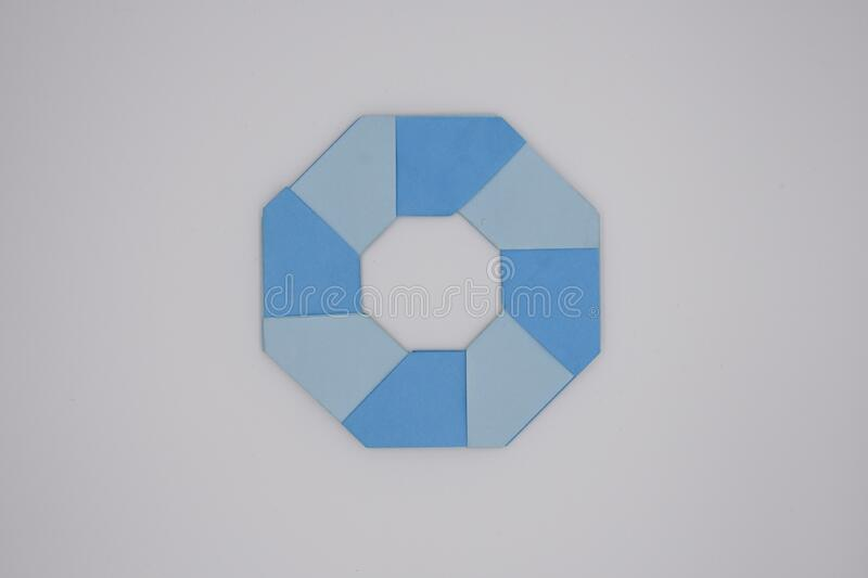8 pointed ninja star paper fold. One blue paper fold of 8 pointed ninja star was taken royalty free stock images