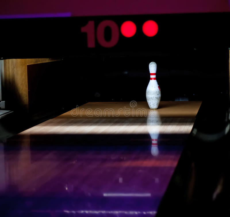 One bowl left. In bowling lane royalty free stock images