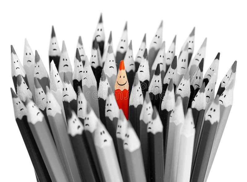 One bright smiling pencil among bunch of gray sad royalty free stock images