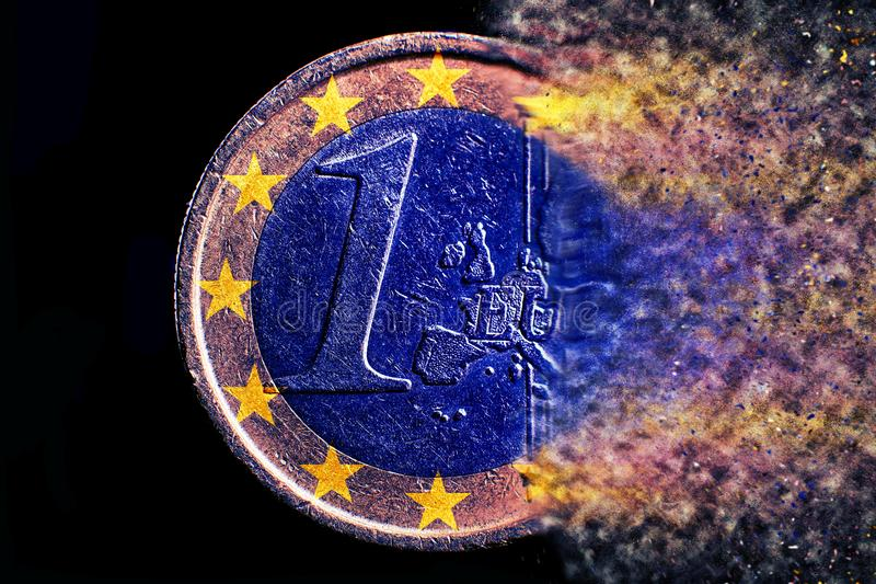 One broken euro coin explosion close up royalty free stock image