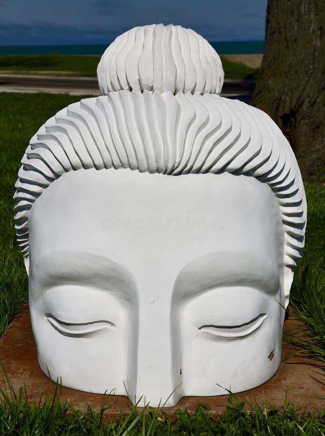 One of 10,000 Buddha Heads stock photo