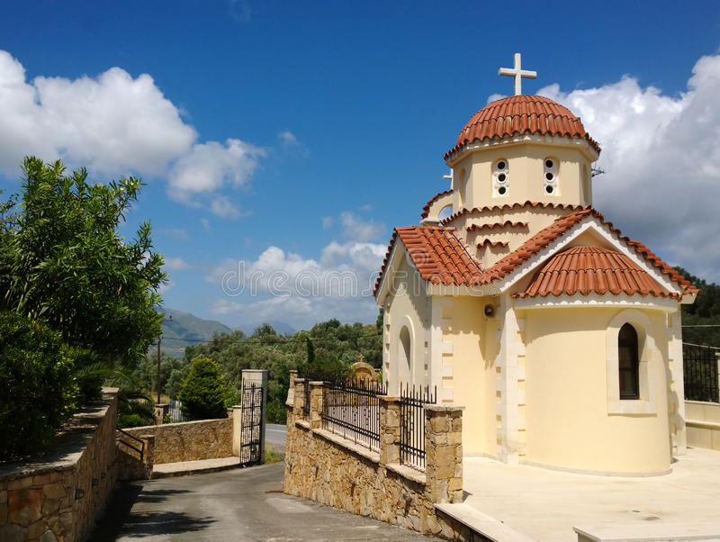 One of the buildings of the monastery in the village of Spili on the island of Crete and the street next to it royalty free stock photos