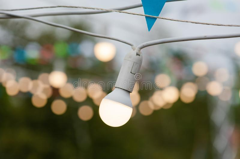 One bulb and bokeh of other garland stock photos