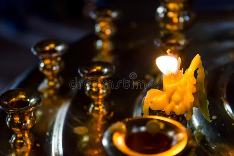 One burning candle in the Church like an angel stock photo