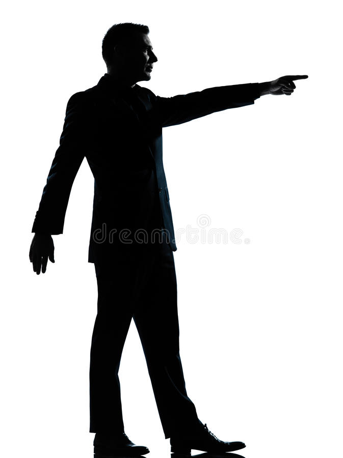 One business man poiting silhouette. One caucasian business man silhouette standing poiting Full length in studio isolated on white background royalty free stock photography