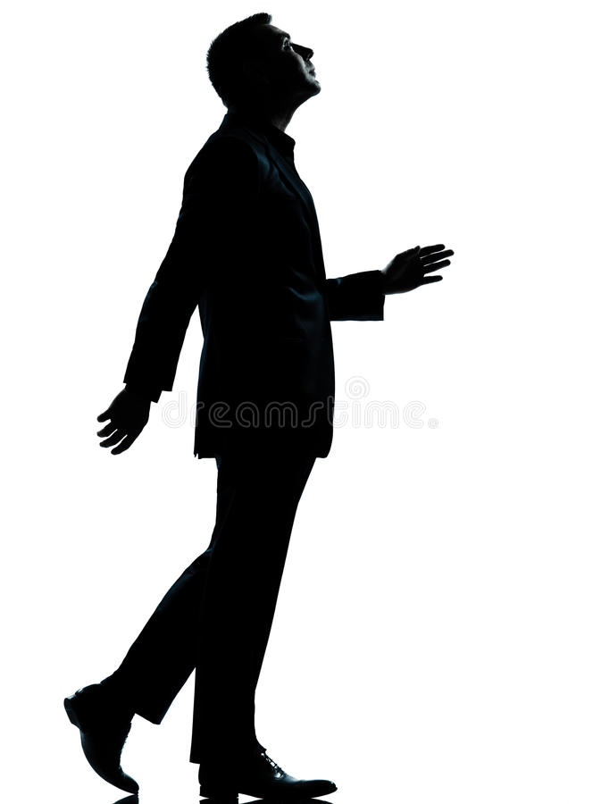 One business man walking looking up silhouette stock photo