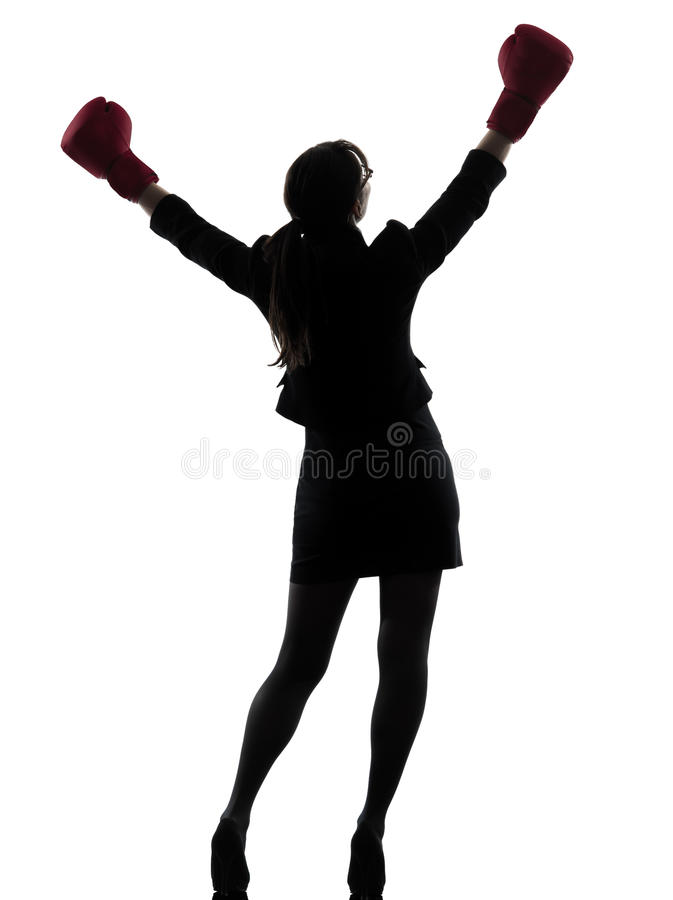 Business woman boxing gloves silhouette. One business woman with box g gloves silhouette studio on white background stock photo