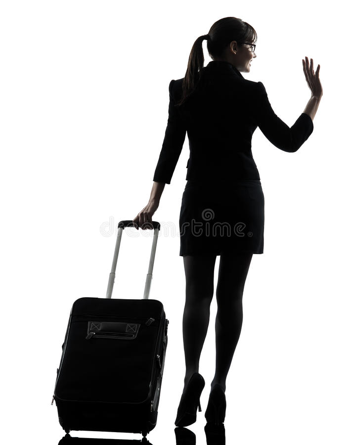 Rear view business woman traveling saluting silhouette royalty free stock photography