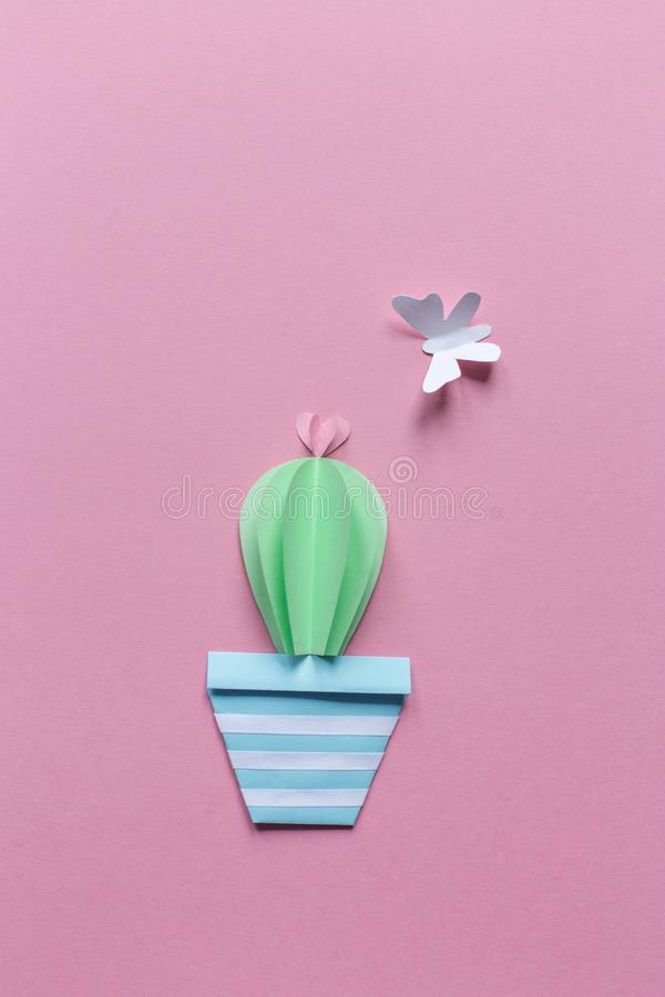One cactus of paper with white butterfly, pink background royalty free stock images
