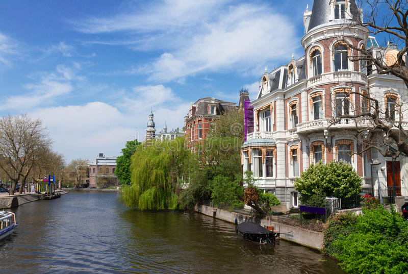 One of canals in Amsterdam, Holland. One of canals in Amsterdam old town at spring day, Holland royalty free stock photo
