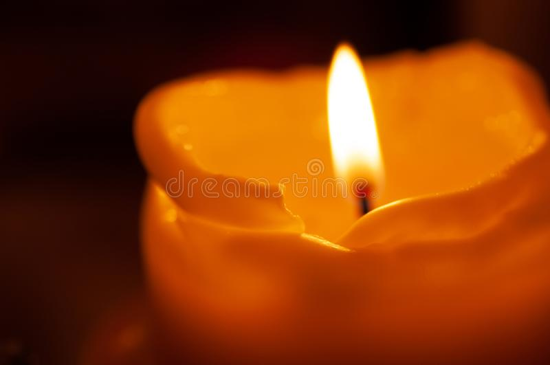 One candle flame at night closeup - isolated, macro.  royalty free stock photos