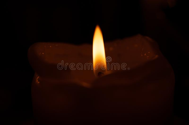 One candle flame at night closeup - isolated, macro.  royalty free stock photo