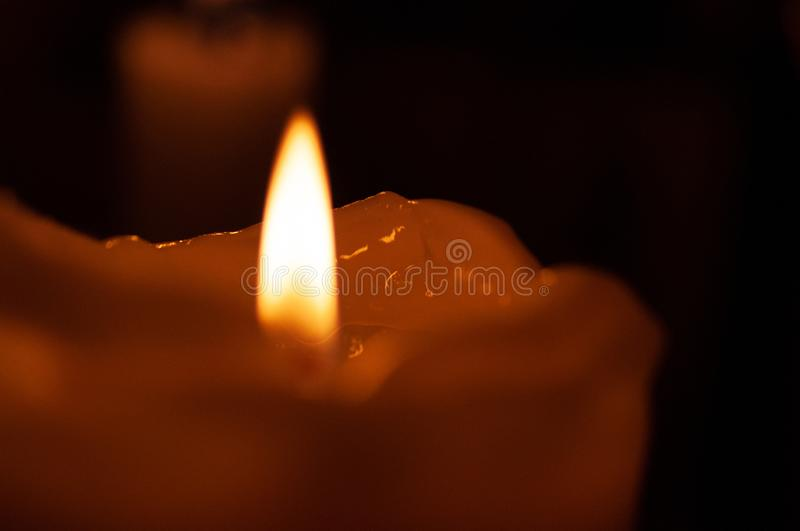 One candle flame at night closeup - isolated, macro.  royalty free stock image