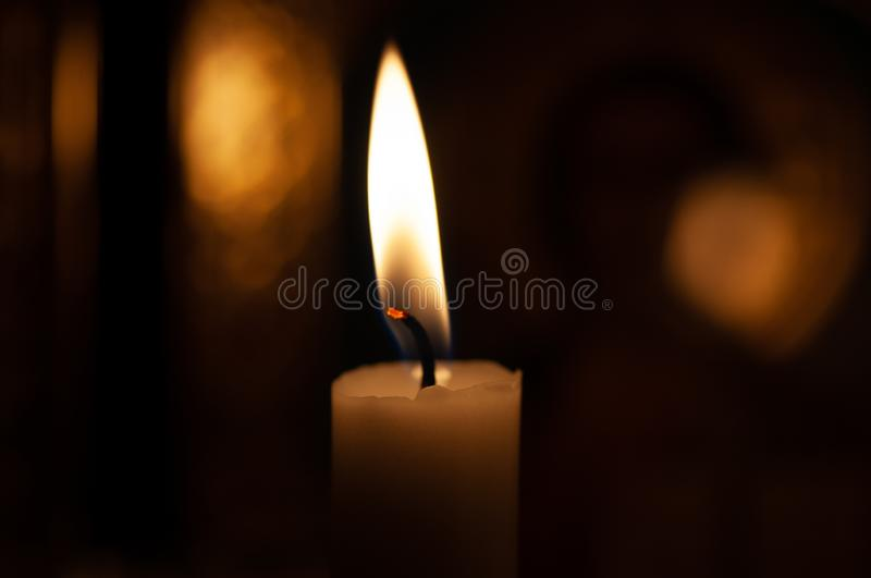 One candle flame at night closeup - isolated, macro.  stock photos