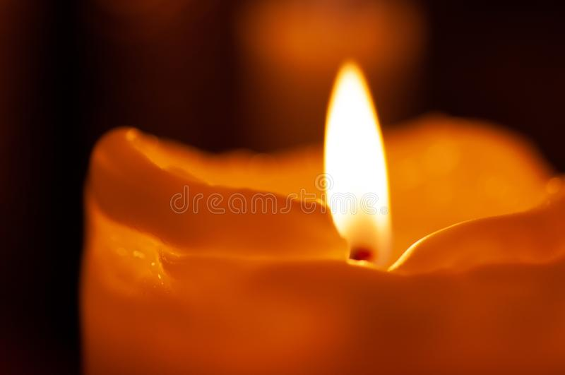 One candle flame at night closeup - isolated, macro.  royalty free stock photography