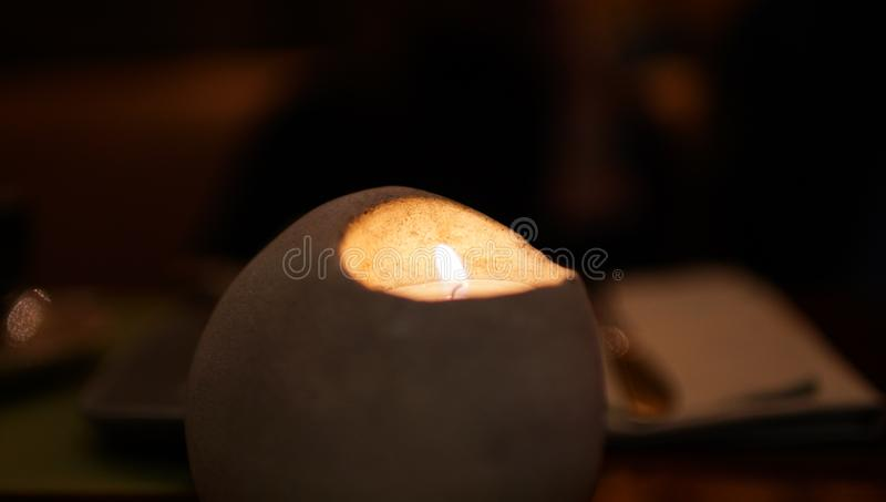 One candle in original shape candlestick at night closeup. Isolated, macro royalty free stock photos