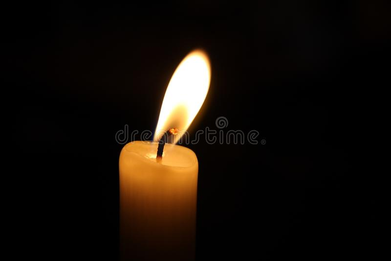 Candle shining in the dark royalty free stock image