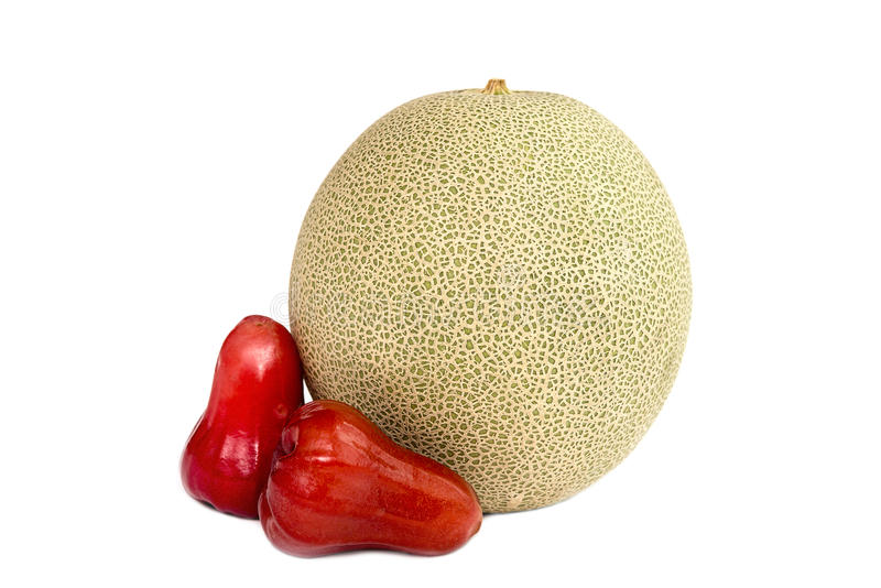 One cantaloupe melon and rose apple isolated on white background.  royalty free stock images