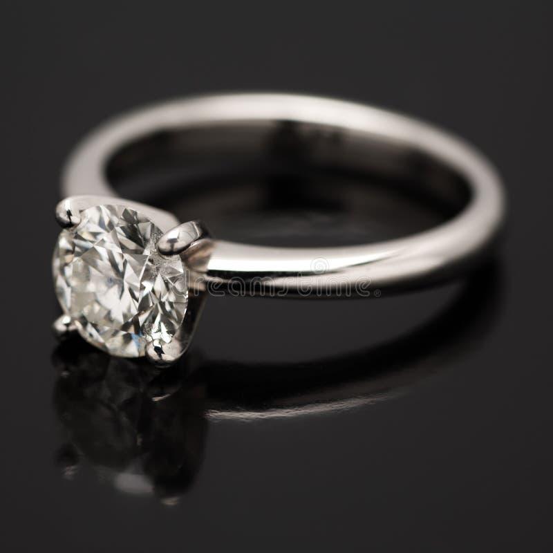 One Carat Diamond Solitaire. One Carat Diamond Solitaire on black background stock photo