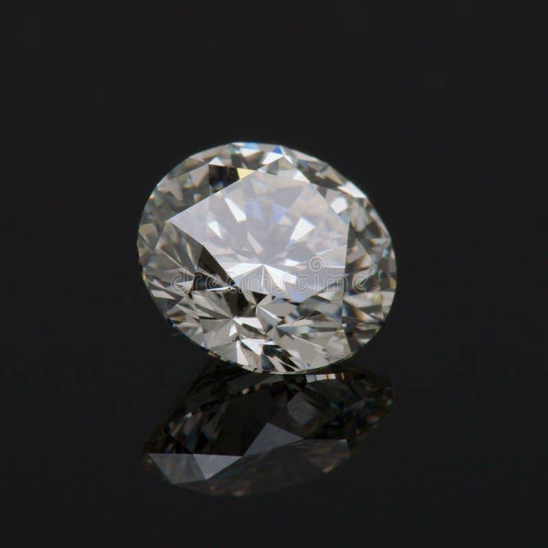 One Carat Round Diamond. One Carat round brilliant cut Diamond on black background stock images