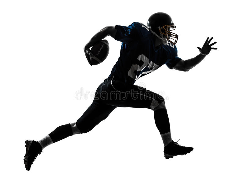 American football player man running silhouette. One caucasian american football player man running in silhouette studio isolated on white background