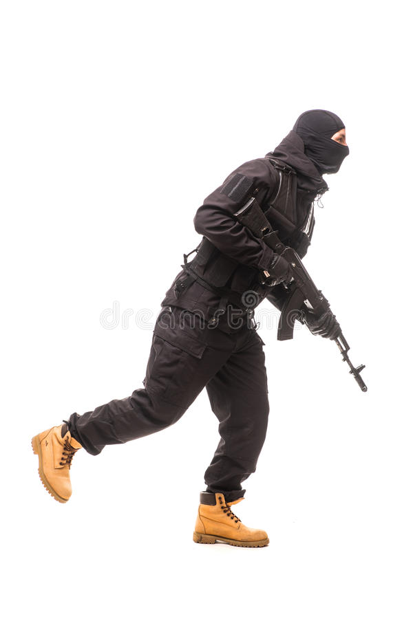 One caucasian army soldier man attacking on studio isolated stock photography