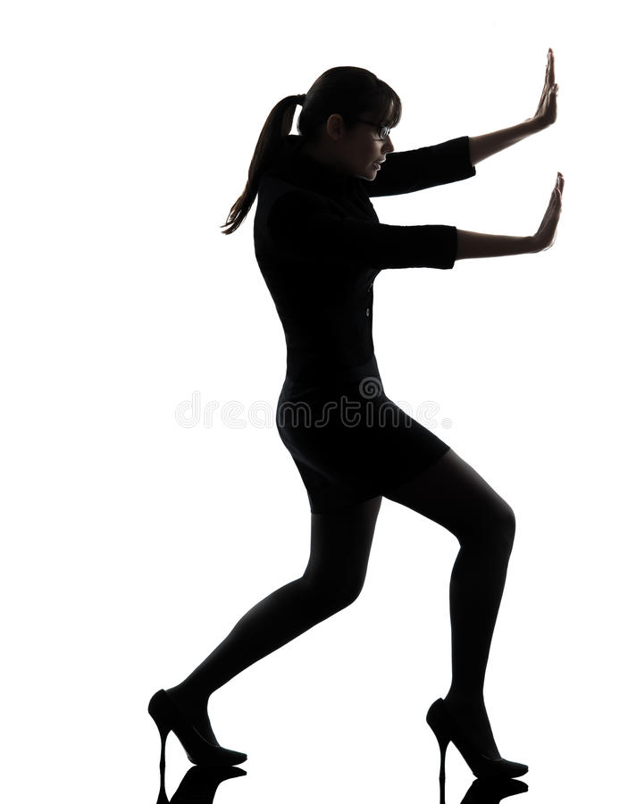 Business woman pushing silhouette stock images