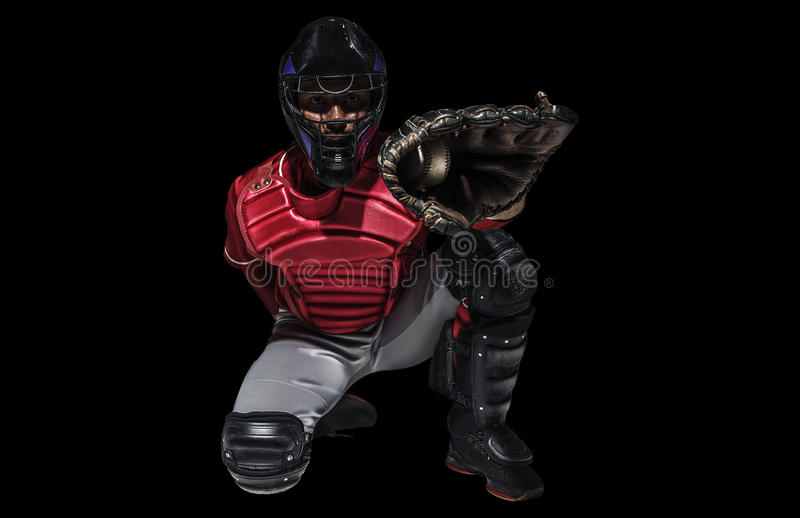 One caucasian man baseball player catcher isolated on black stock photography