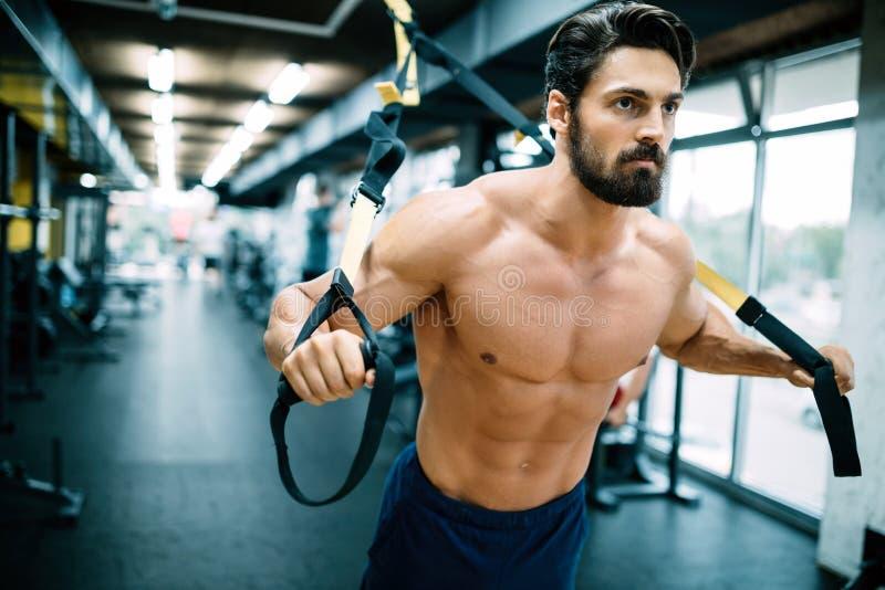 Caucasian man exercising suspension training trx stock photos