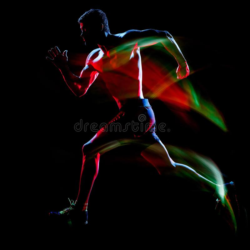 Topless muscular man runner. running jogger jogging isolated black background royalty free stock photos