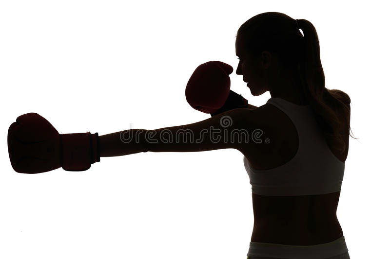 One caucasian woman boxing exercising in silhouette studio isola. Ted on white background stock image