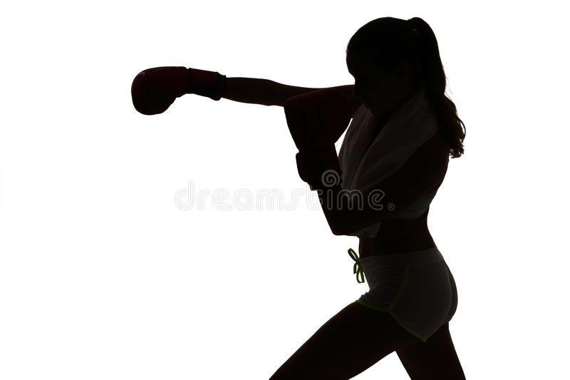 One caucasian woman boxing exercising in silhouette studio isola. Ted on white background stock photography