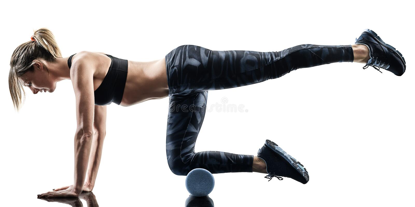Woman pilates fitness foam roller exercises silhouette isolated stock photo