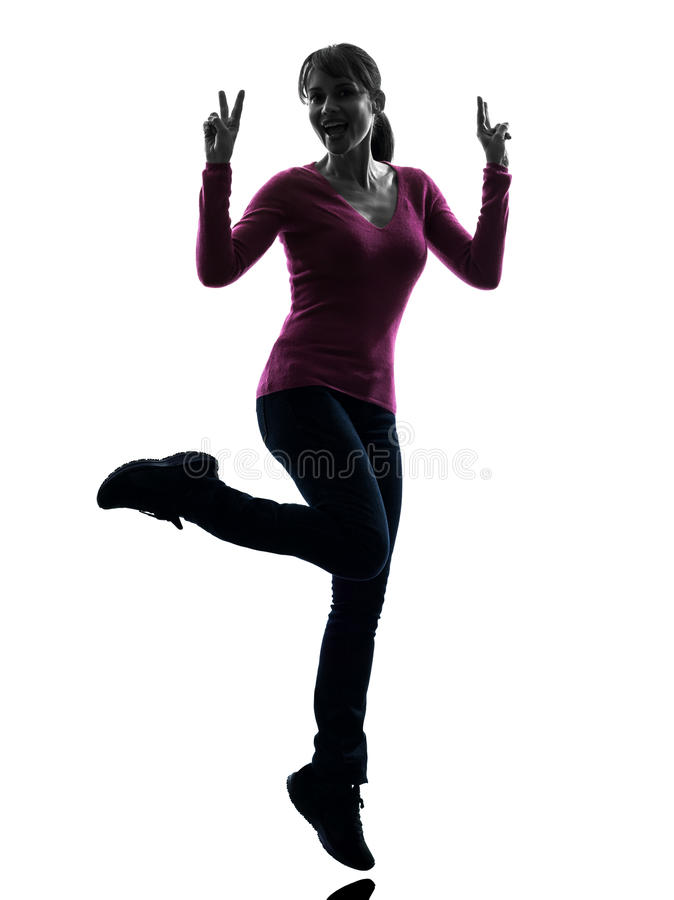 Woman full length peace gesture silhouette stock photography