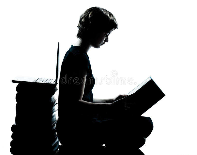 One caucasian young teenager silhouette boy or girl reading stock image