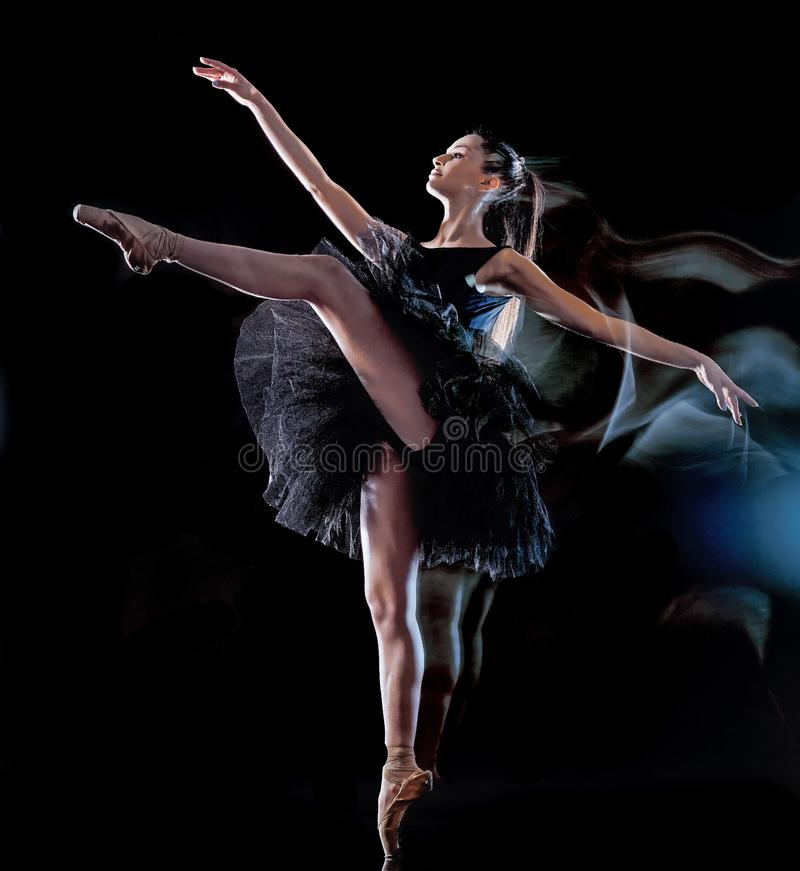 Young woman ballerina  dancer dancing  black background light painting royalty free stock photography