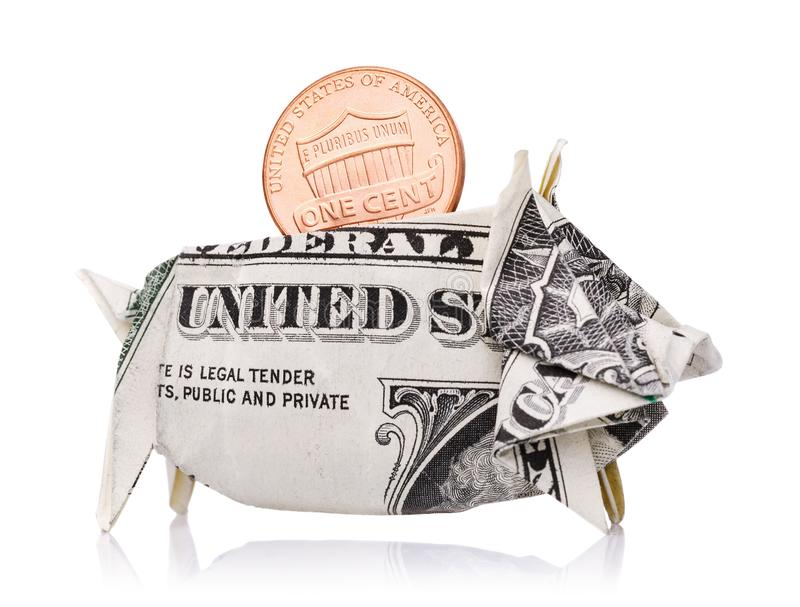 One cent in a piggy bank of an American dollar isolated stock photography