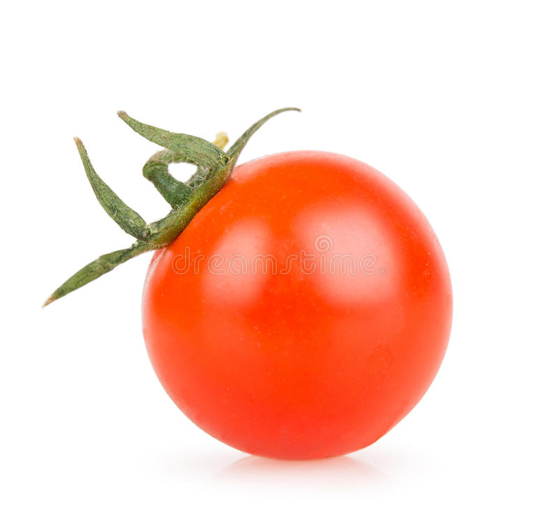 One cherry tomato on a white background royalty free stock images