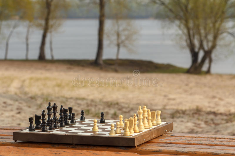 One chess pieces staying against black chess pieces Chess board stock images